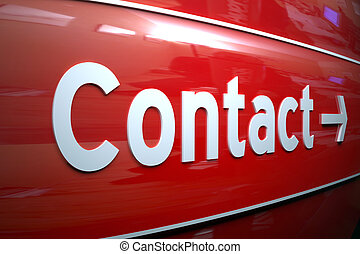 CONTACT SIGN - White contact sign on the shiny remarkable...
