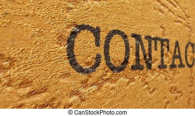 Contact text on grunge background