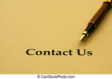 A piece of paper with the words contact us and a pen, contact us