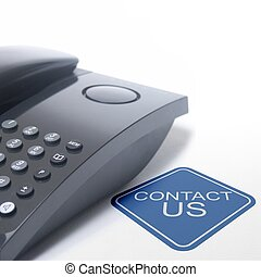 black telephone isolated on a white background, with contact us sign