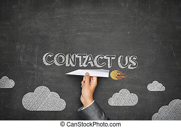 Contact us concept on black blackboard with businessman hand...