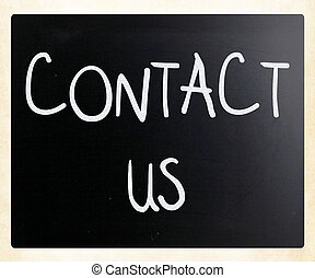 """""""Contact Us"""" handwritten with white chalk on a blackboard"""