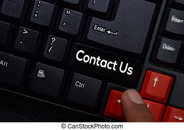 Contact Us isolated on laptop keyboard background