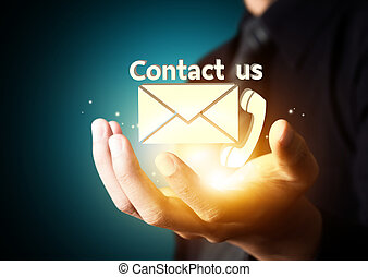 Contact us symbol in businessman hand, Email icon
