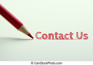 Contact us word is standing on the paper with red pencil ...