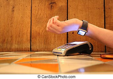 contactless payment apple watch pdq with hand holding credit...