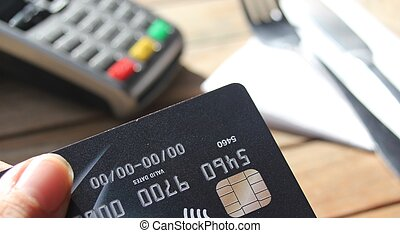contactless payment card pdq with hand holding credit card...
