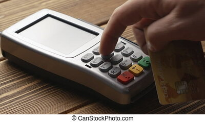 Contactless payment with credit card - Closeup shot of...