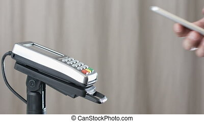 Contactless payment with smartphone - Side view of person...