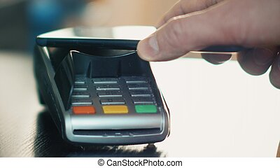 Contactless payment with smartphone with NFC technlogy.