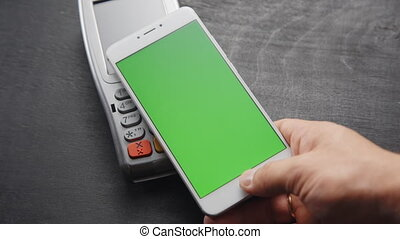 Contactless smartphone payment. - Top view of person using...