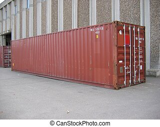 Container - A container standing outside a warehouse.