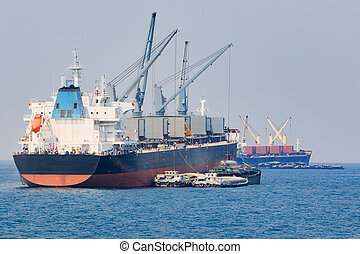 container boat loading goods over clear blue water sea use for vessel ,nautical transportation and ocean logistic industry
