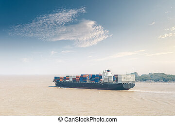container cargo ship out of the harbor