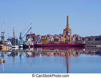 Container operation in port. Kronstadt, St. Petersburg, Russia