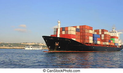 Container ship arriving in port on a very calm day