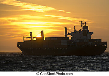 Container ship in front of sunset