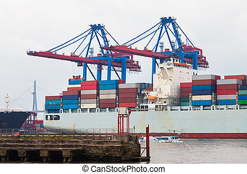 Container ship in port terminal