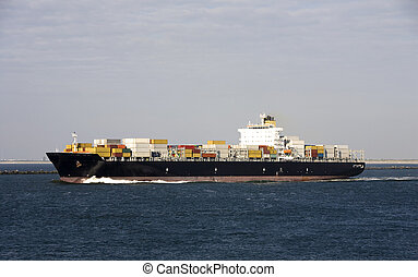 Container ship is leaving the Port of Rotterdam