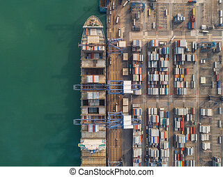 Container ship loading from logistic hub