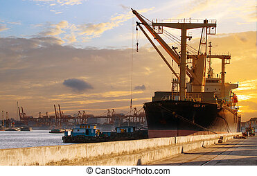 container ship loading material goods from local ship in habor port use for import ,export nauticla ,vessel and logistic transportation