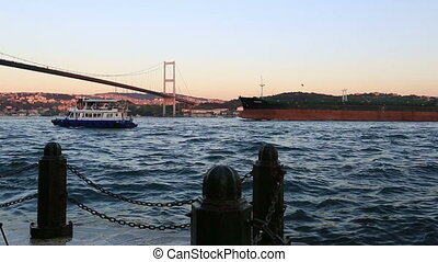 Bosporus Bridge - container ship passing under the Bosporus...
