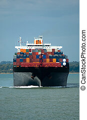 container ship - fully loaded container ship head-on in calm...
