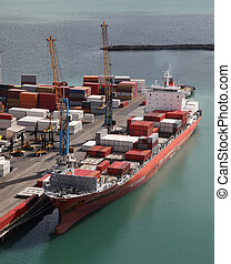 Container ship - A container ship unloading at port in...