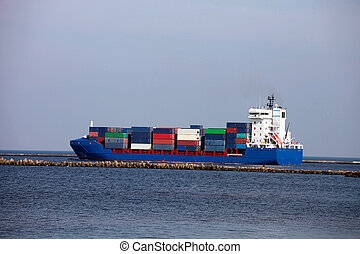 Container ship - Large container ship leaving harbor