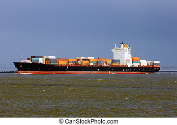 Container ship leaving the port of Rotterdam