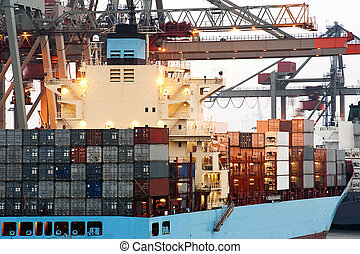 Container ship - A huge container ship being unloaded at...