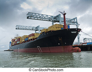 Container ship being loaded in harbor