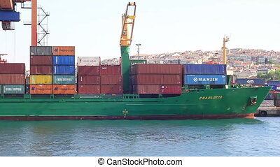 Container ship with Chinese goods - Container ship unloads...