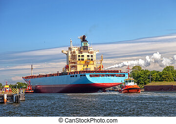 Container ship with tugboat