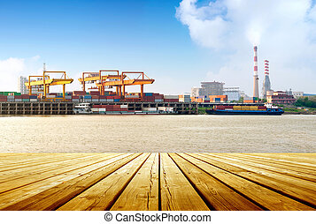 Container stacks and ship under crane bridge - Cargo sea...