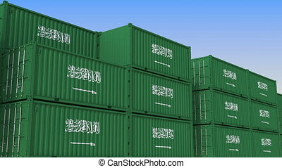 Container terminal full of containers with flag of Saudi...