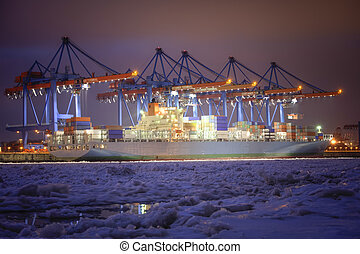 Container Terminal in Hamburg, Germany - during winter.