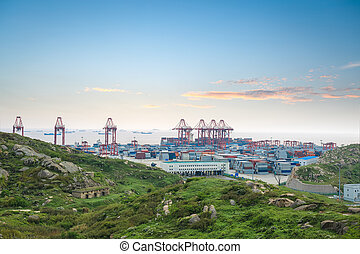 container terminal in sunset glow