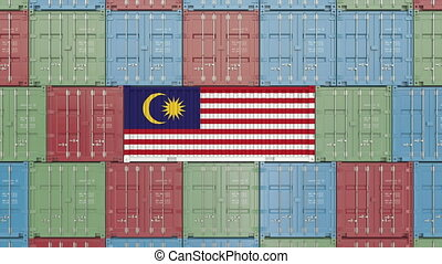 Container with flag of Malaysia. Malaysian import or export...