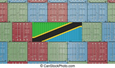 Container with flag of Tanzania. Tanzanian goods related...