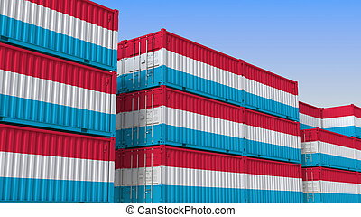 Container yard full of containers with flag of Luxembourg. ...