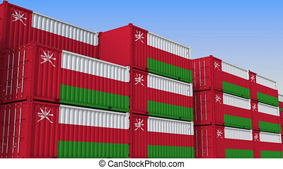 Container yard full of containers with flag of Oman. Omani...