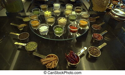 Containers filled with different spices - A steady, medium...