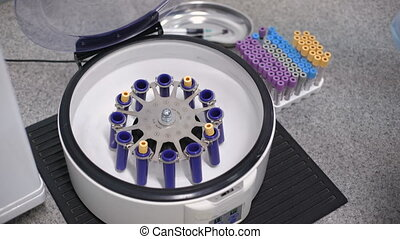 Containers for tubes of biochemical analyzer. Doctor removes...
