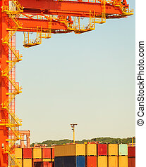 Containers transported by crane. Industrial equipment in...