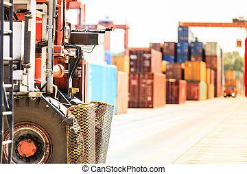 Containers with forklift car. Cargo in harbour with...