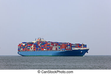 containership entering the harbour of rotterdam