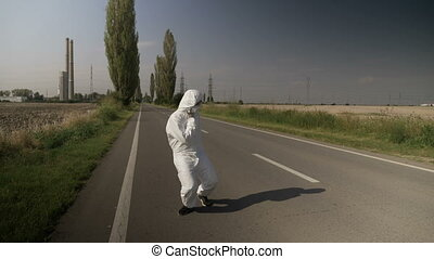 Contaminated ecologist worker in hazmat suit chocking and...