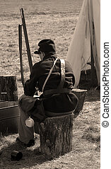 Contemplation - A civil war soldier sitting on a stump with...