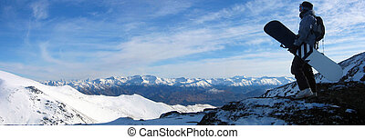 Contemplation - snowboarder looking at mountain ranges